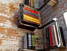 Galvanized pipes, elbows, and flanges are not only meant for plumbing purposes. This DIY bookshelf is the proof.