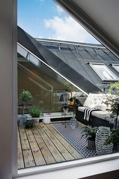 Small balcony oasis with plants and beautiful outdoor interior.