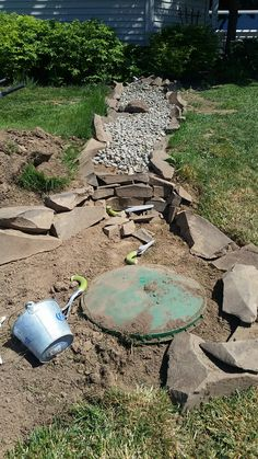 septic tank access hidden under dry creek i placed larger rocks on top of two already so its easy to get to them and remember where they are