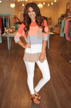 Coral tunic and white pants