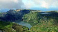 This is a crater lake on Flores island, sometimes called lagoons.  The crater is of a now extinct volcano.  There is a variety of them on Flores: different shapes, deep cones, shallow cones, 2-lake crater, ones of an easy hike, and ones of difficult climbing.
