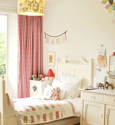SHARING A ROOM — A GIRL'S AND BOY'S SIDE could add gingham curtains to the room possibly in red to add shared effect rather than current florals