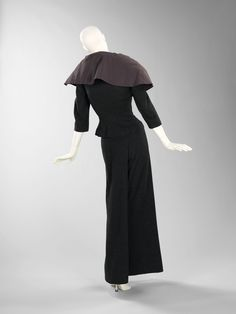 Dinner suit, Charles James, 1950; wool, silk. A combination of skirt and pants, the innovative design wraps one leg like a trouser and crosses over in front to cover the other like a skirt.