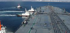 """""""Tugging The Giant"""" : Tugs and VLCC Tohshi going along side at Chiba, Japan.    Pic by kushmeet singh (https://www.facebook.com/kushmeet.singh.98)    www.marineinsight.com"""
