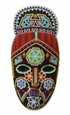 "Beadwork mask, 'Crowned Deer' by NOVICA. $144.99. Keep out of the sun. Keep out of heat. A fair trade product. Handmade by Higinio Hernandez Carrillo. Normally ships directly from Mexico within 10 days.. NOVICA, in association with National Geographic, searches the world to work directly with the finest artisan designers. Beaded female mask on a papier maché backing by Higinio Hernandez, featuring a distinctive marra (Huichol for ""deer"") design on the crown. Patter..."