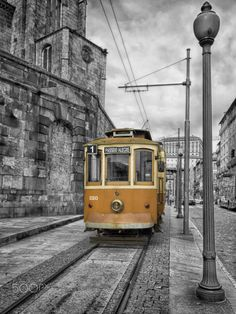 """Electric historical tram, Porto, Portugal - The network of electric historical tramcars of STCP, SA - Porto Tram City Tours – constitutes an inescapable ex-libris of Oporto city. With a history dating back to 1872, when the first line of """"American cars"""" of the city of Porto was inaugurated, the network of electric cars is currently constituted by 3 distinct STCP lines that run through the most emblematic areas of the city."""