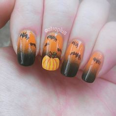 Pin for Later: 102 Halloween Nail Art Ideas That Are Better Than Your Costume Spooky Pumpkin Patch