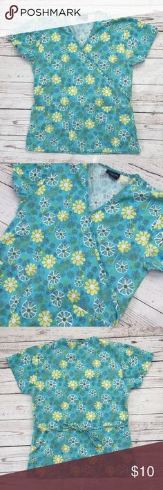 """-Absolute- Scrub Top Turquoise Floral Tie Back Pretty floral Scrub Top!  Measurements: Armpit to Armpit:  19"""" (laying flat) Length: 26"""" (shoulder seam to hem)  Condition: Gently used condition; No stains, rips or tears  Please review pictures for product details.  Please email me with any questions.  Thank you for looking! Absolute Tops"""