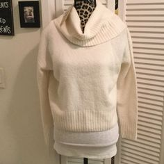 Michael Kors sweater in Cream authentic Super cute Long sleeve sweater in cream with cowl neck  in size petite medium, fabric is 40% acrylic, 26% wool, 14% cotton, and 2% elastane, washable. Perfect for any time authentic purchased at Macy's new with tags never worn Michael Kors Sweaters Cowl & Turtlenecks
