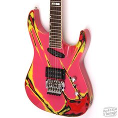 ESP M-1. Not sure what I like more, that amazing custom paint job or the scalloped neck heel.