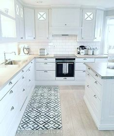 Love the subway tiles and all white. Black knobs instead of silver, maybe black . Love the subway tiles and all white. Black knobs instead of silver, maybe black faucet. Couple all glass cabinet doors. Grey and white marble counter tops Kitchen Room Design, Home Decor Kitchen, Interior Design Kitchen, New Kitchen, Home Kitchens, Kitchen Ideas, White Kitchen Cabinets, Kitchen Countertops, Glass Cabinet Doors
