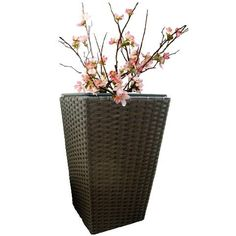 Hand-woven plastic rattan over metal frame and includes plastic liner with removable drain plug for indoor or outdoor use. Available in three sizes and four colors (black shown here). Rattan Planters, Drain Plugs, Outdoor Gardens, Hand Weaving, Indoor, Plastic, Vase, Metal, Brown