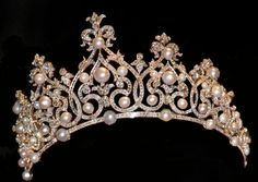 Diamond Pearl Tiara 1897: The Ornate Pearl Tiara is created for the young Queen Wilhelmina a year ahead of her enthronement festivities. The piece, which is set with diamonds, 35 round pearls, and 11 pear-shaped pearls, was likely made by Royal Van Kempen en Begeer. Some have speculated that the tiara was actually a remodeled version of a diamond and pearl tiara from the collection of Queen Sophie, possibly that unseen tiara inherited by Prince Alexander.