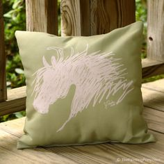 Moss green and ivory colored horse head throw pillow for the equestrian home decor.