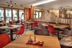 Upholstered Step chairs from our Tonon collection at a restaurant in Austria. Hospitality, Interior, Design.