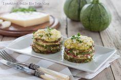 La parmigiana di zucchine con Asiago Fresco Dop è un ottimos econdo piatto, gustoso e di stagione. Servitelo in monoporzioni, ancora calde e con il cuore filante.