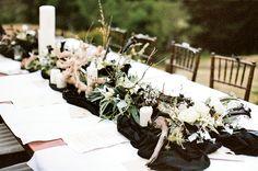black calla lilies, berries, & grasses centerpiece