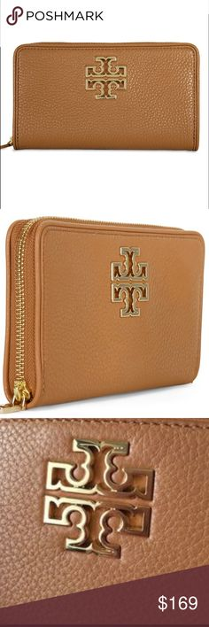 """Tory burch Britten wallet bark Color: Bark (brown) 209 Pebbled Leather Exterior: 3/4  Zip Around Closure Removable Wristlet Strap 6 slots & 1 smartphone slot Measurements: 6"""" W x 3.5"""" H x 1"""" D Tory Burch Bags Wallets"""