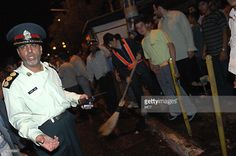 TEHRAN, IRAN -- Police clear the site of an explosion at Imam Hussein Square in Tehran, Iran, on Sunday, June Tehran Iran, Police, June, Sunday, Domingo, Law Enforcement