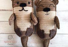 Crochet otters side by side