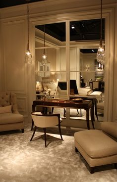 """This is a Baker showroom but the mirrored """"window"""" could work anywhere."""