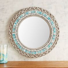 This is more than just a place to check your reflection. With its hand-carved wooden frame, radial mosaic pattern of aqua tiles and hand-painted finish, our exclusive mirror is also a work of art. Bathroom Paint Finish, Wood Bathroom, Bathroom Colors, Mirror Bathroom, Bathroom Ideas, Tumblr Wall Art, Coastal Mirrors, Coastal Rugs, Bedroom Art