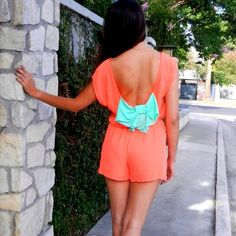 Orange romper with mint bow on a back Hot orange romper with cute mint bow on a back. Made in USA 🇺🇸 Pants Jumpsuits & Rompers