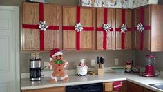 Christmas decor for our kitchen...except the bows keep falling down