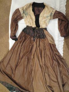 """interior - 1860's Changeable Silk Gown Civil War Dress eBay seller coda2222, all hand stitched, fully lined, 1/2"""" black chantilly lace at neck; bodice, waist & sleeves - black silk; front placket has one large snap (!); front closure, some alterations made, 2.5"""" double ruffle at shoulder; cartridge pleated, hidden slated pocket, brown glazed cotton lining on skirt & sleeves, bodice inner linen corset with eyelets for lacing; bust: 32.5""""; waist: 25""""; skirt length: 42""""; hem width: 132"""""""