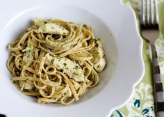 3 boneless, skinless chicken breast halves (6 to 8 ounces each) Coarse salt and ground pepper 1 tablespoon olive oil 1/2 pound whole wheat fettuccine (I used whole wheat linguine, it was what I had) 1/2 cup Basil Pesto 1/4 cup heavy cream