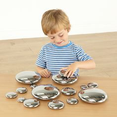 Set of 20 mirror pebbles in different sizes. Perfect for stacking, sorting and sequencing.