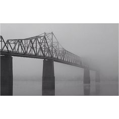 The Madison-Milton Bridge shot early on a foggy morning from the bank of the Ohio River.