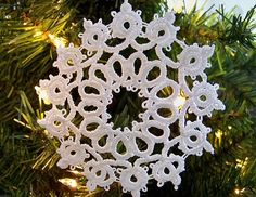 Tatted snowflake ornament.
