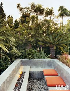 The sunken outdoor seating area at a Palos Verdes, California, home provides a warm refuge with or without a fire. #HouseandGarden
