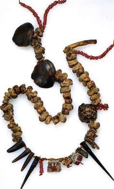 "South Africa | Shaman's necklace from the Zulu people; twigs, tortoiseshell, seeds, animal knuckle bone and horn, teeth, glass beads and leather | Private collection' Ivory Freidus.  | Pg 121 ""The Worldwide History of Beads"" by Lois Sherr Dubin. 2009 edition."
