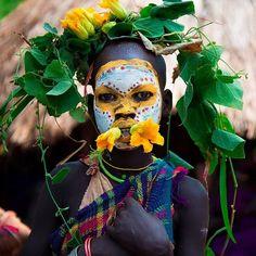 Photo by © Konstantino Hatzisarros  A suri tribe boy in Ethiopia