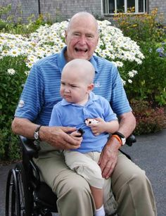 Former President George Bush shaves his head to show solidarity for young Patrick the son one one of his Secret service agents who has leukeamia.
