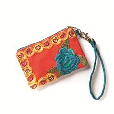 Orange #Wristlet This darling wristlet is covered in all sorts of pretty details. Featuring burnt-orange canvas, zippered top, removable turquoise strap, stunning embroidered roses, and twirly yellow trim, its perfect for stashing your essentials! Grab it on the go or keep it in your purse for easy access to cards and ID. Great gift idea for girls!