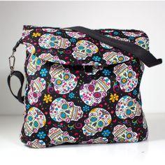 Sac á langer Folk Skull du style besace pour poussette.Des crâne mexicane et la forme du sac donne à ce sac à langer une élégance sportive,Le compartiment principal s´ouvre pour permettre de superviser le contenu.Vous êtes parfaitement équipés avec ce sac à langer.
