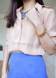 Style trick: you usually see a statement necklace worn on top of a shirt--here it's worn in the neckline.