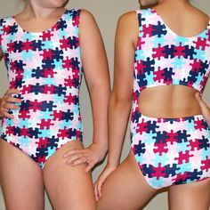 http://foxysfitnessfashions.com/?product=fits-like-a-puzzle  really cool gymnastics leotards for girls by Foxy's Fitness Fashions. Made by a family of gymnasts since 1984. Best quality, fit, style, and prices!!! ***  http://www.foxysfitnessfashions.com