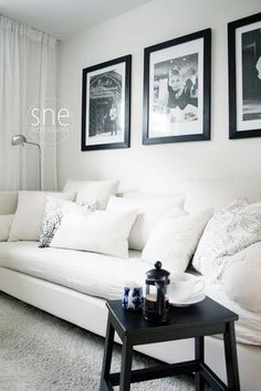 Big framed black and white prints for big wall behind couch?
