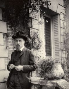 Rainer Maria Rilke. By George Bernard Shaw. 1906. Rainer Maria Rilke stood leaning against a balustrade in front of a house. Taken at August Rodin's house, Villa Mendon. Silver gelatin print. Monochrome.