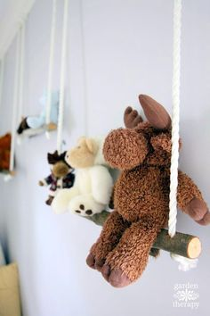 Branch swing shelves - create shelves, or swings, out of branches for all the stuffed toys. This is a fairly simple project, at a very low cost, that looks like a million bucks! Use them for toys, books, or whatever you want to display. Step-by-step tutorial with photos.