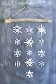 Snowflake Wall Hanging, so cute!! Paper snowflakes from birch wood, adore!