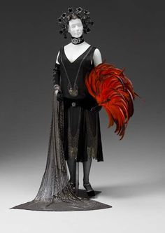 Circa 1920-1925 silk chiffon, velvet, glass bead, and sequin dress (hva).
