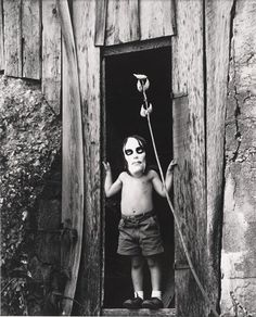 "Ralph Eugene Meatyard, ""Untitled [Masked Boy Standing in Doorway]"" (ca. 1959) 