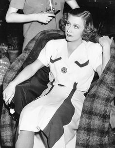 Irene Dunne on the set of Love Affair (1939)...looks like her dress fell asleep while waiting for Irene to get her hair done
