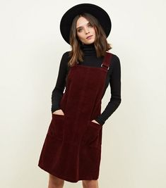 Dress to impress with this pinafore dress. Style it with a stripe T-Shirt underneath and trainers for a cool entry into the weekend. - All-over corduroy finish - Thick straps - Double front pocket - Square neckline - Mini length - Soft cotton corduroy fin Winter Dress Outfits, Casual Outfits, Cute Outfits, Fashion Outfits, Outfit Winter, Vestidos Jumper, Corduroy Pinafore Dress, Black Pinafore Dress Outfit, Dungaree Dress