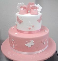 Beautiful pink butterflies baby shower cake with a pair of cute baby shoes as a topping. Torta Baby Shower, Tortas Baby Shower Niña, Girl Shower Cake, Pretty Birthday Cakes, First Birthday Cakes, Birthday Cake Girls, Baby Girl Christening Cake, Baby Girl Cakes, Bolo Barbie